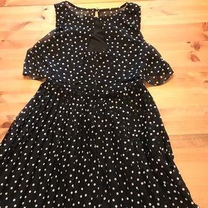 Flirty pleated black and white polka dot dress